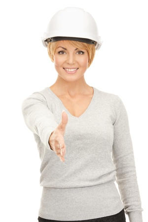 bright picture of female contractor in helmet ready for handshake  photo