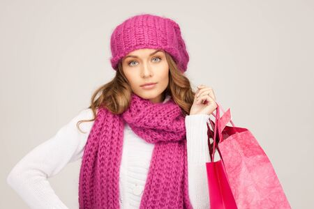 lovely woman with shopping bags over grey Stock Photo - 8740435