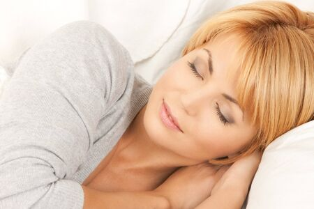 sleepy: bright closeup picture of sleeping woman face  Stock Photo