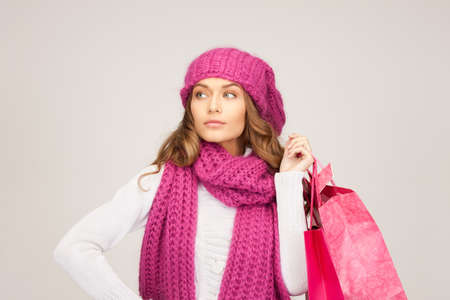 lovely woman with shopping bags over grey Stock Photo - 8740479