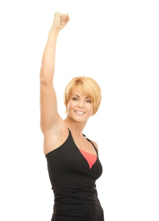 bright picture of lovely fit woman with expression of tryumph over white Stock Photo - 8740493