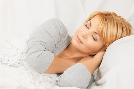 bright closeup picture of sleeping woman face  photo