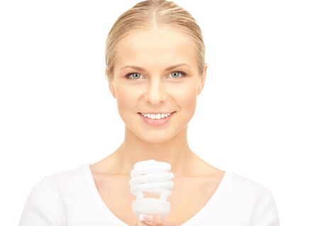 bright picture of woman holding energy saving bulb Stock Photo - 8740491