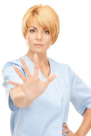 bright picture of attractive female doctor showing stop gesture Stock Photo - 8740719