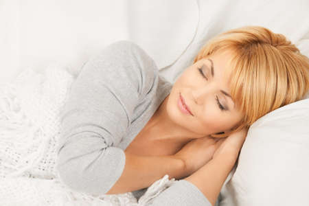 drowse: bright closeup picture of sleeping woman face  Stock Photo