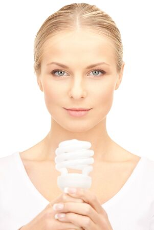 bright picture of woman holding energy saving bulb Stock Photo - 8740670