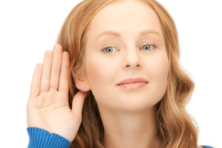 bright picture of young woman listening gossip Stock Photo - 8740705