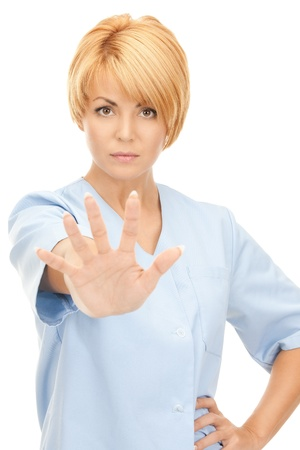 bright picture of attractive female doctor showing stop gesture Stock Photo - 8740806