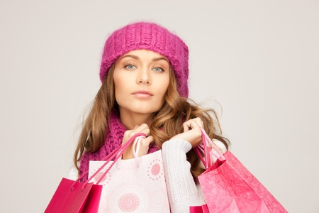 lovely woman with shopping bags over white photo