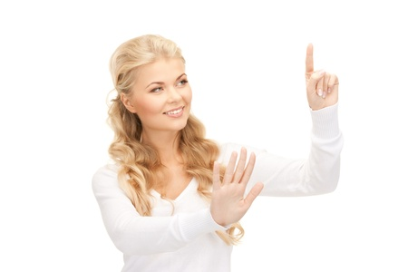 picture of businesswoman working with something imaginary photo
