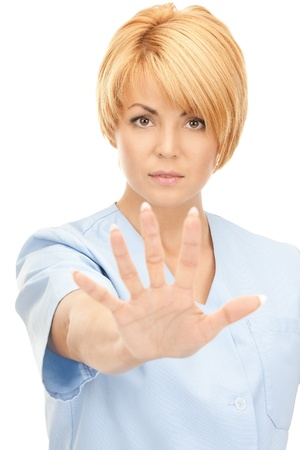 bright picture of attractive female doctor showing stop gesture Stock Photo - 8741003