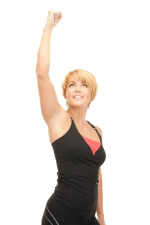 bright picture of lovely fit woman with expression of tryumph over white Stock Photo - 8740849