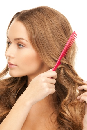 comb hair: bright picture of beautiful woman with comb