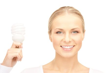 bright picture of woman holding energy saving bulb Stock Photo - 8740843