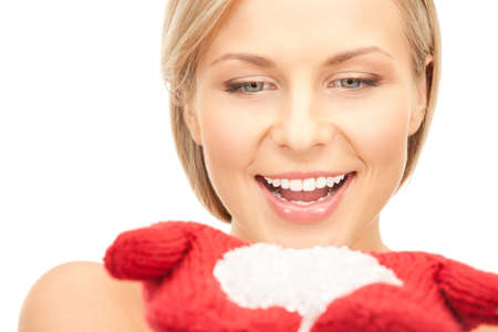picture of beautiful woman in red mittens with snow photo