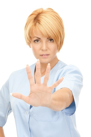 bright picture of attractive female doctor showing stop gesture  photo