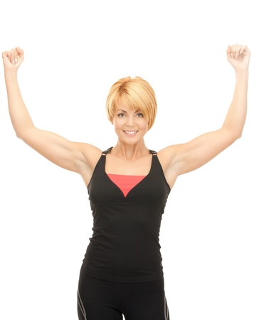 bright picture of lovely fit woman with expression of tryumph over white  photo
