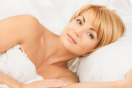 bright closeup picture of  woman in bed  photo