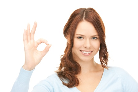 bright picture of lovely woman showing ok sign photo