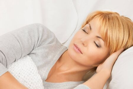 pillow sleep: bright closeup picture of sleeping woman face  Stock Photo