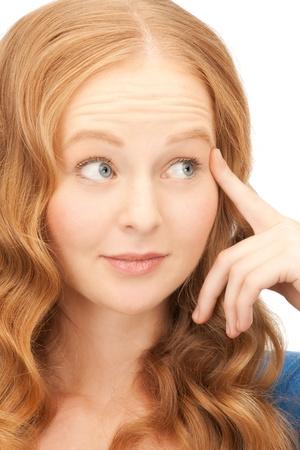 bright picture of pensive businesswoman over white Stock Photo - 8862265
