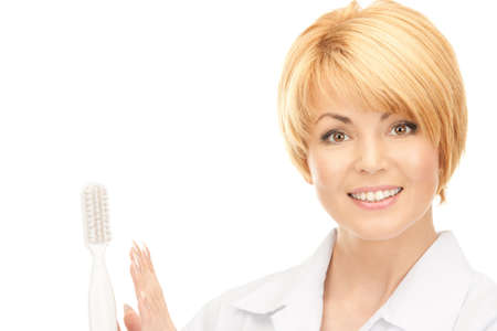 picture of attractive female doctor with toothbrush photo