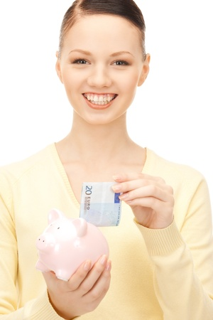 picture of lovely woman with piggy bank Stock Photo - 8867929