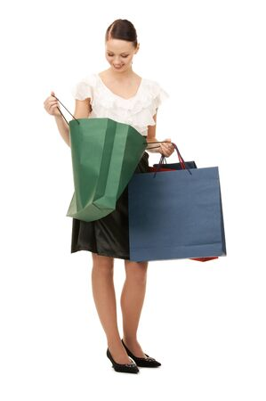 satisfied customer: lovely woman with shopping bags over white