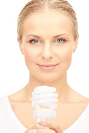 bright picture of woman holding energy saving bulb Stock Photo - 8862338
