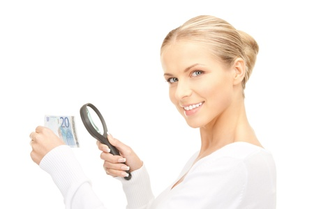 lovely woman with magnifying glass and money photo