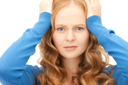 bright picture of unhappy woman over white Stock Photo - 8865474