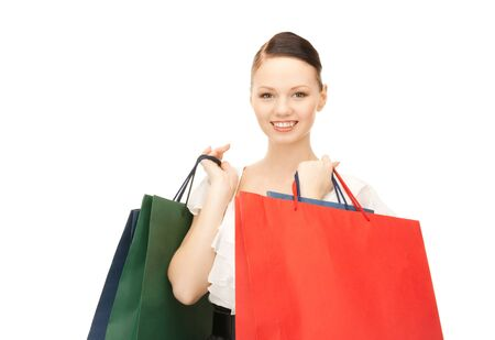 lovely woman with shopping bags over white Stock Photo - 8865497
