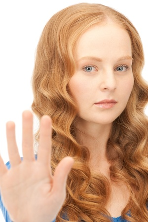 bright picture of young woman making stop gesture Stock Photo - 8866456
