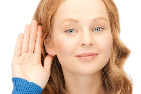 bright picture of young woman listening gossip Stock Photo - 9545842
