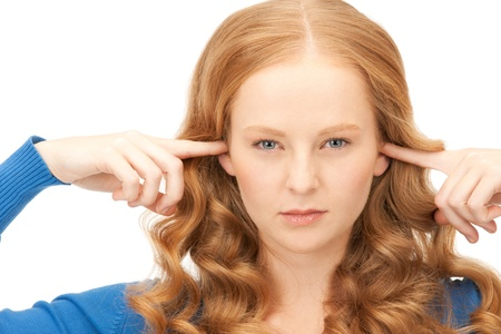 picture of woman with fingers in ears Stock Photo - 16344144