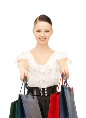 lovely woman with shopping bags over white Stock Photo - 8867351