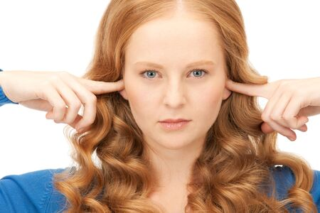 picture of woman with fingers in ears Stock Photo - 8867390