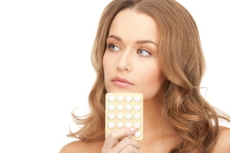 pharmaceutics: picture of young beautiful woman with pills