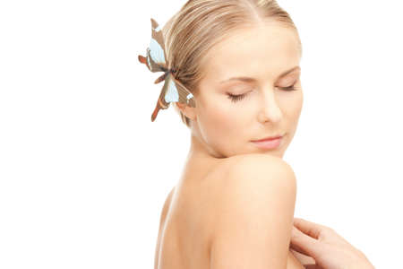 picture of beautiful woman with butterfly in hair photo