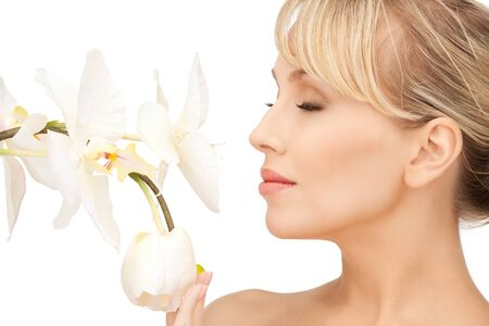 picture of beautiful woman with orchid flower Stock Photo - 8867473