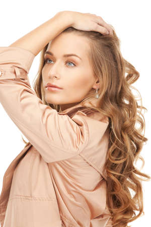 bright picture of lovely woman in coat Stock Photo - 8981739
