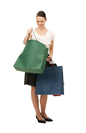 lovely woman with shopping bags over white Stock Photo - 8986172