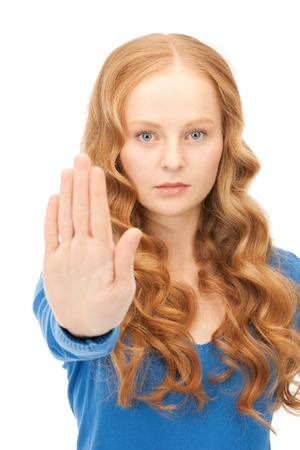 bright picture of young woman making stop gesture Stock Photo - 8985290