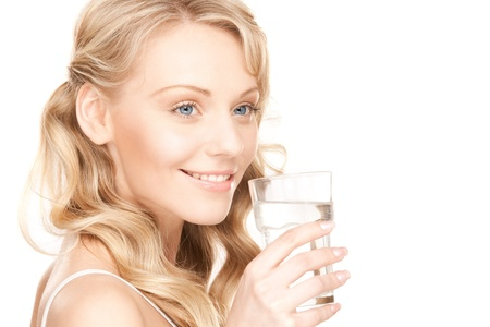 slender woman: beautiful woman with glass of water over white