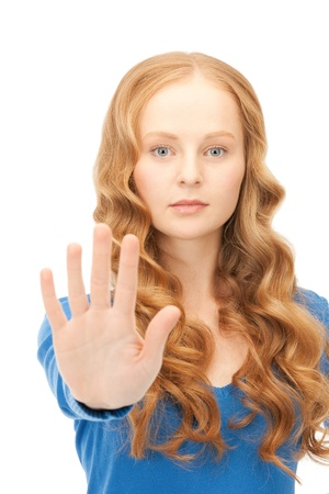 bright picture of young woman making stop gesture Stock Photo - 8987140