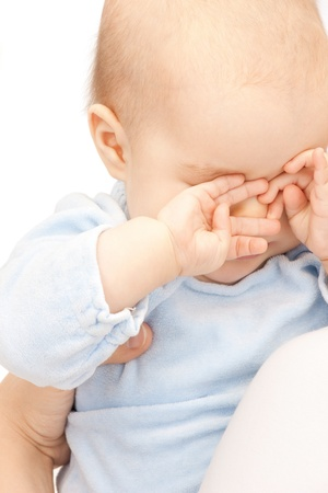 sleepy: bright picture of adorable baby over white  Stock Photo