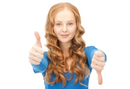 bright picture of lovely teenage girl with thumbs up and thumbs down Stock Photo - 9046007