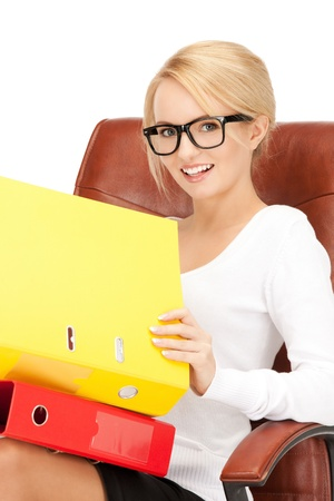 picture of young businesswoman with folders sitting in chair Stock Photo - 9047911