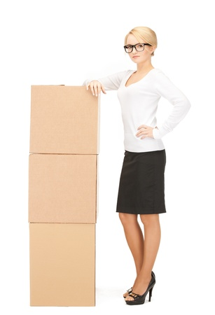 picture of attractive businesswoman with big boxes 