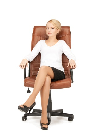 lovely businesswoman: picture of young businesswoman sitting in chair